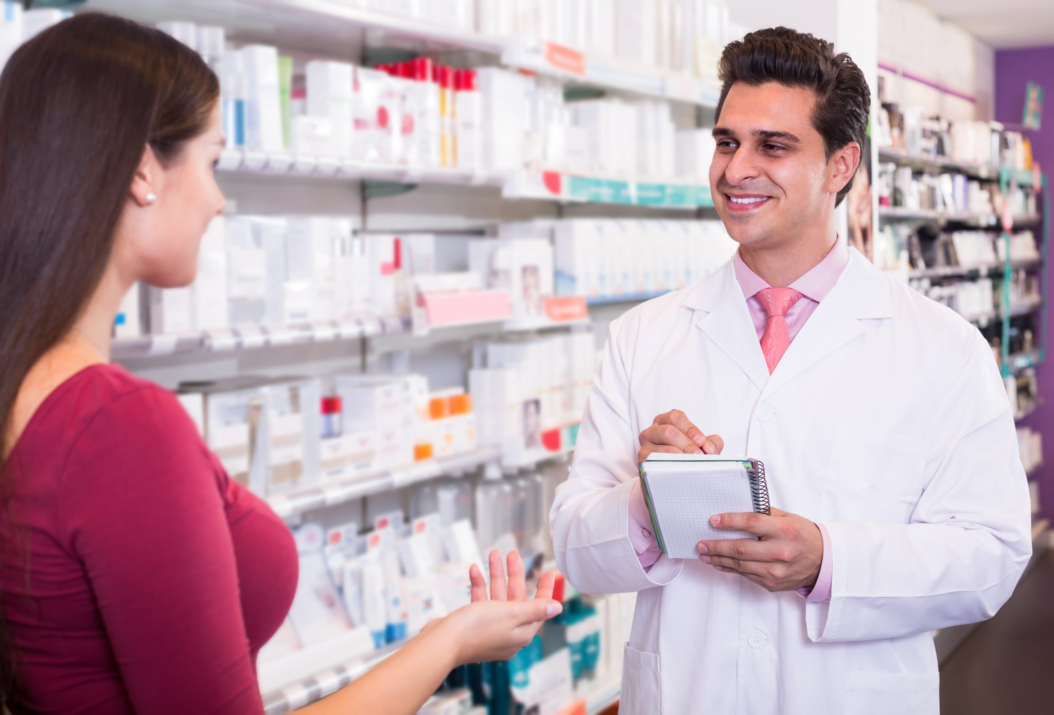 Centrum Pharmacy - Professional pharmaceutist in drugstore helping girl